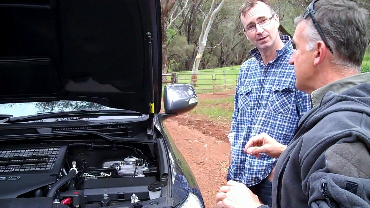 Glynn explaining four-wheel drive daily pre-checks to a new four-wheel drive owner.
