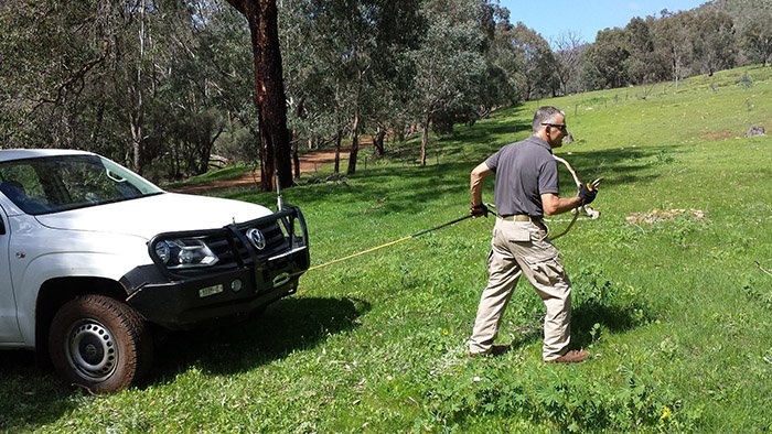 Glynn demonstrating safe four-wheel drive winch recovery techniques.